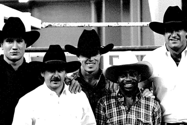 AZ Cardinals Quarterback Tim Rosenbaum, CEO of CLN Patrick O'Donnell, Charlie Sampson, 3x World Champion Bull Rider Tuff Hedeman, and Mark Walzack AZ Cardinals Tight End in 1995 at the Rodeo of Rodeos in Phoenix Arizona