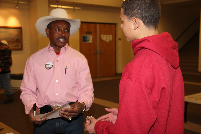 Charlie Sampson talks to Elyjah Dryden, 13, Chadron, son of Jessica Dryden at Chadron State College Nebraska. (Photo by Tena L. Cook)